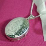 Silver Family Locket (Oval, patterned) for 4 photos,  personalised engraved ref. FOL4